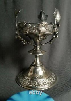 STUNNING ART GLASS vase in figural antique silverplate frame stand. OPALESCENT